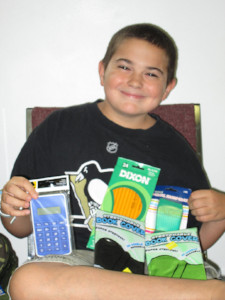 Child with school supplies